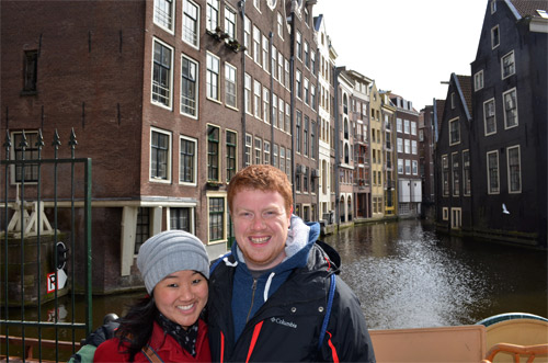 Standing in front of a canal in Amsterdam