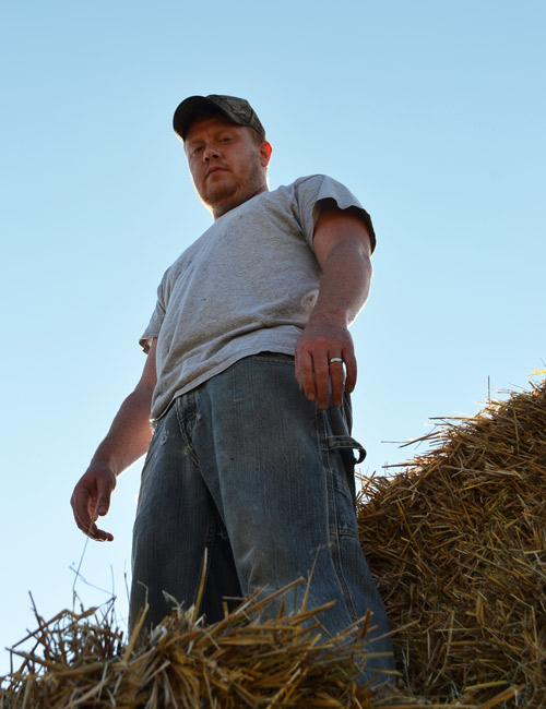 Farmer Dave baling straw