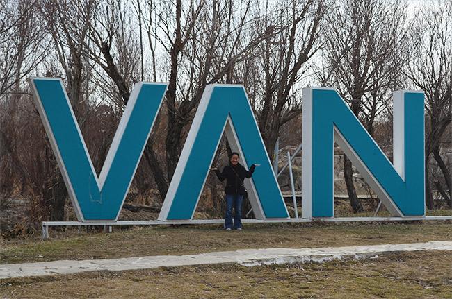 Leah by a Van sign