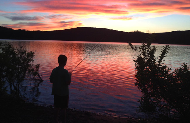 Ben fishing at sunset