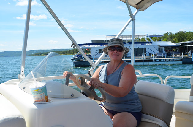 Mom driving the pontoon