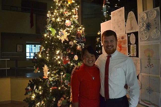Leah and David by Christmas tree