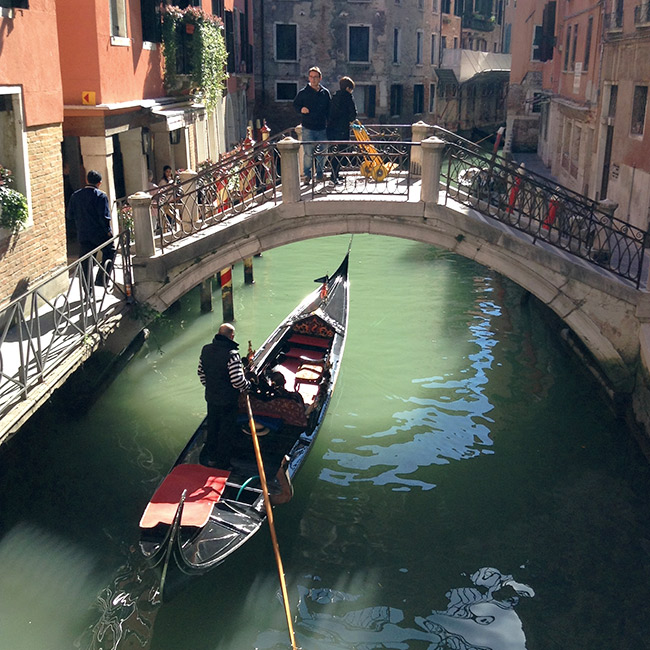 Gondola going under a bridge