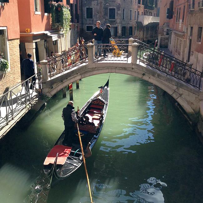 Gondola going under a bridge