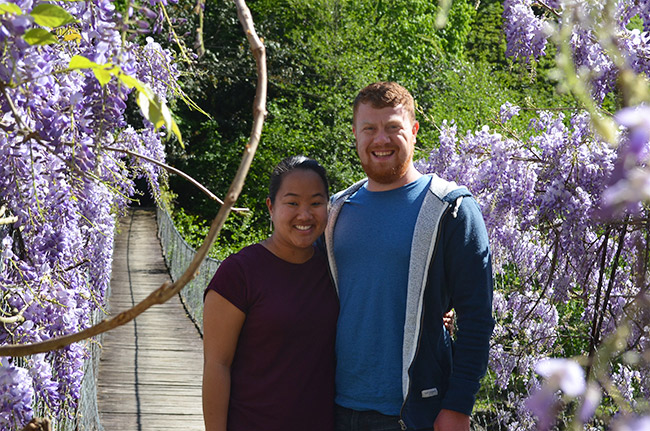 David and Leah on a wisteria bridge