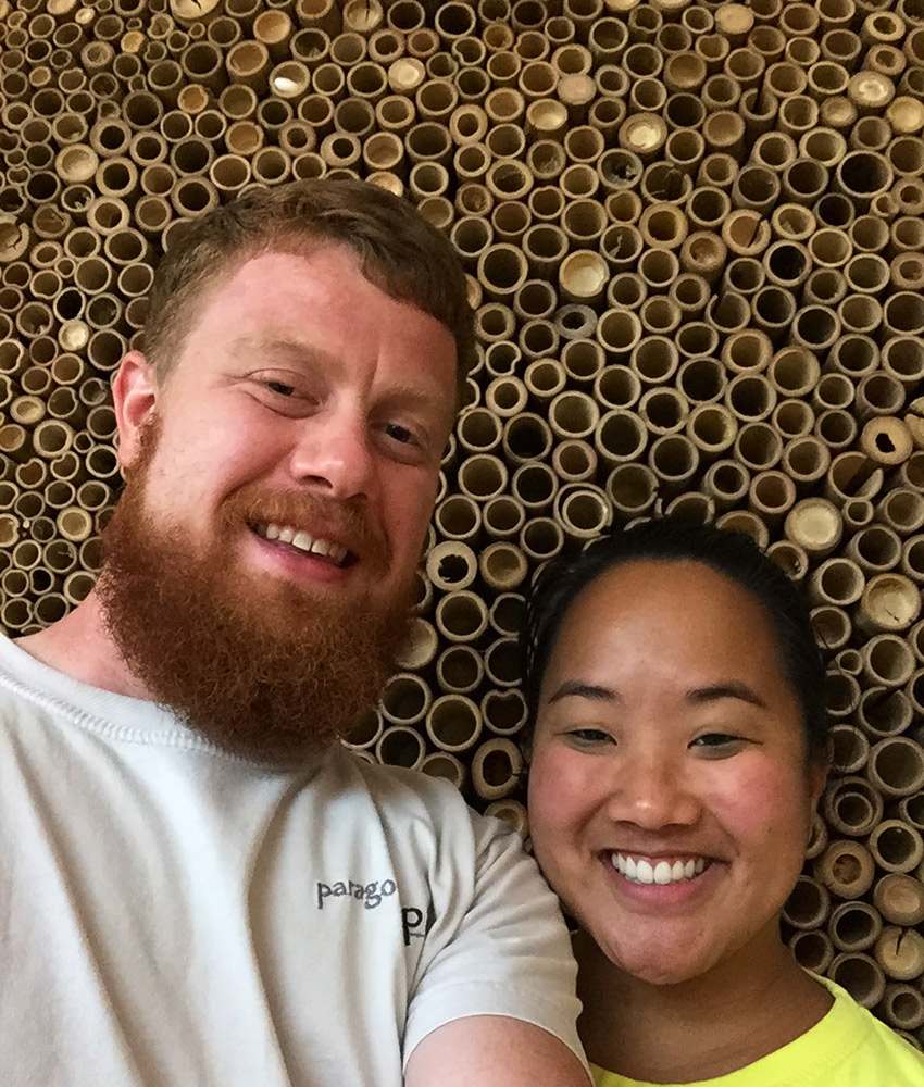 David and Leah in front of bamboo wall