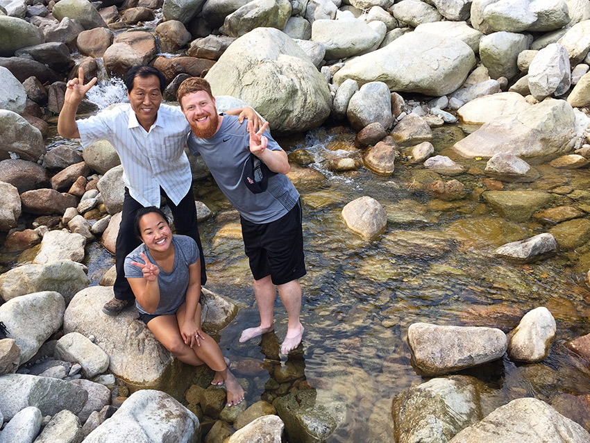 Posing with Korean man in a stream