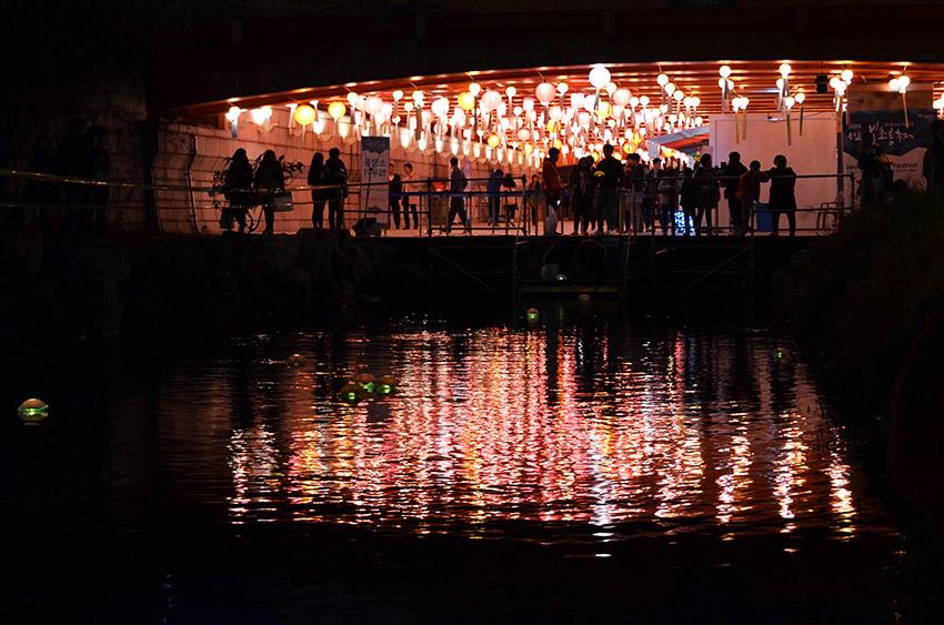 Bridge, lanterns, and reflections