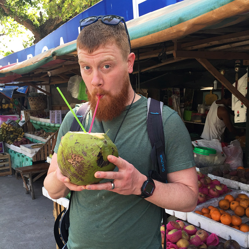 David drinking out of a coconut