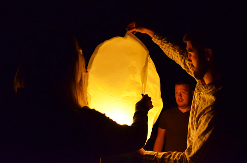 Lighting a paper lantern