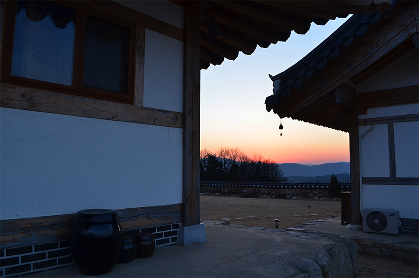 Gyeongju sunset with hanok roofs