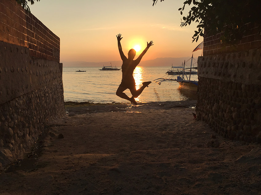 Jumping on the beach at sunset